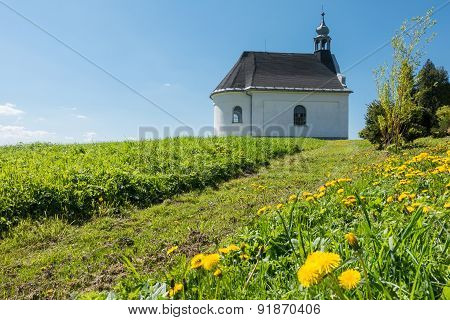 Rural Baroque Chapel On Flowering Meadow