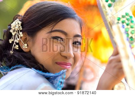 BAGAN, MYANMAR, JANUARY 22, 2015: Portrait of a Burmese beautiful woman in traditional dress and makeup for a religious Buddhist celebration in Bagan, Myanmar (Burma)