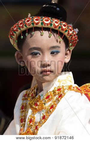 BAGAN, MYANMAR, JANUARY 22, 2015: Portrait of a Burmese kid in traditional costume and makeup for a religious Buddhist celebration in Bagan, Myanmar (Burma)