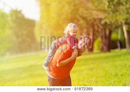 mother and little daughter having fun outdoors