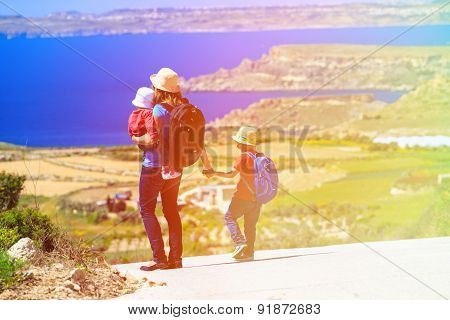 mother with kids travel on scenic road