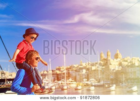 father and son playing on the quay of Malta