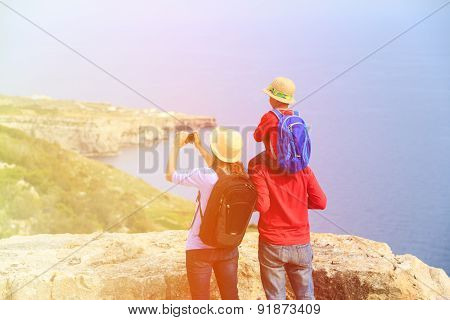 family with small kid travel in mountains