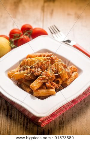 spaghetti with swordfish ragout and lemon peel,  selective focus
