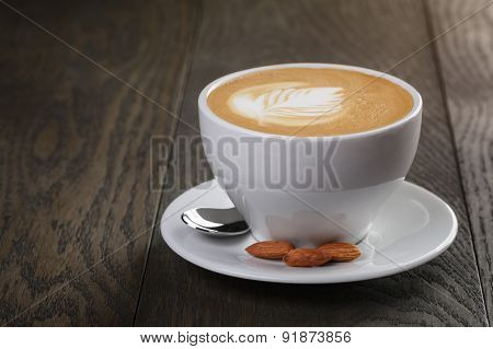 cup of freshly made cappuccino with latte art
