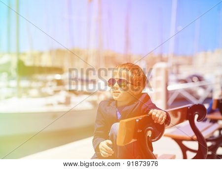 happy little tourist in european harbor