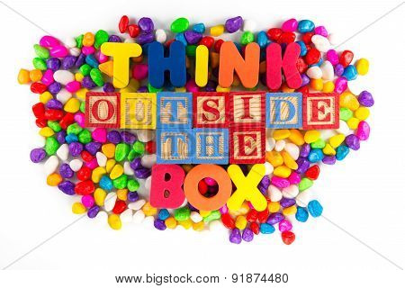 Think Outside The Box Word In Colorful Stone