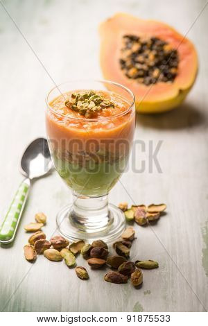 mousse with papaia and pistachio nut,selective focus