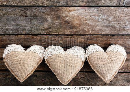 Vintage hearts on wooden background