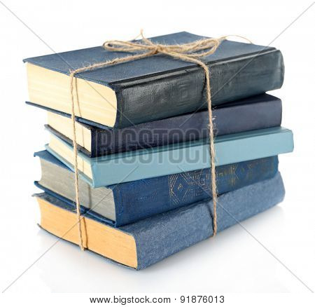 Stack of tied books isolated on white