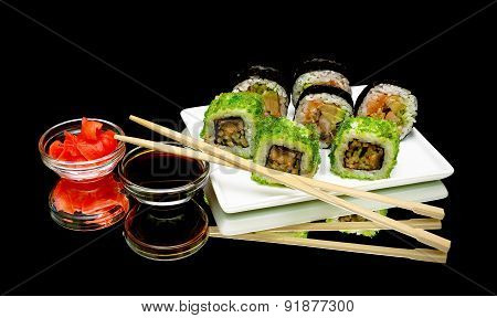 Japanese Rolls, Soy Sauce And Pickled Ginger On A Black Background