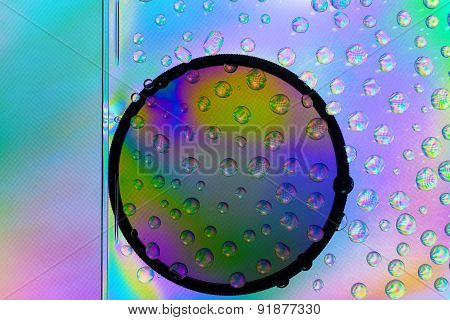 Amazing colors of white light that pass through the clear plastic, water drops and CPL filter.