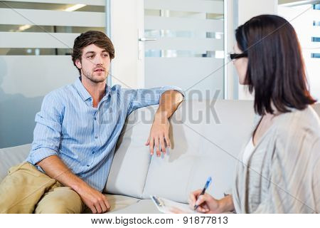 Psychologist talking with depressed man in the office