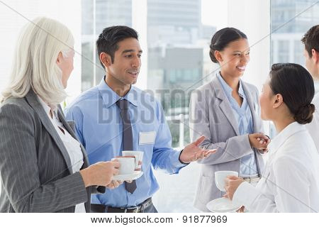 Happy work team during break time in office