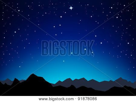 starry sky above mountains