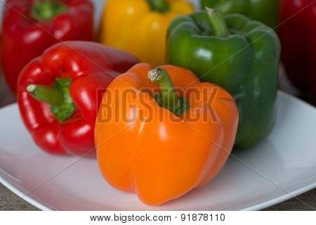 Orange Sweet Pepper on White Plate