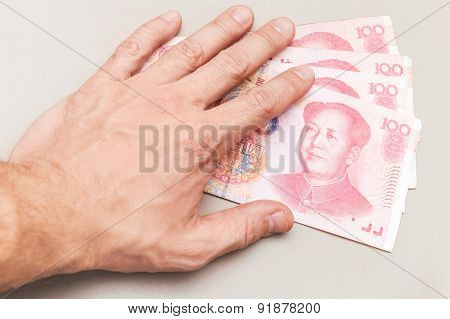 Chinese 100 Yuan Renminbi Banknotes And Male Hand