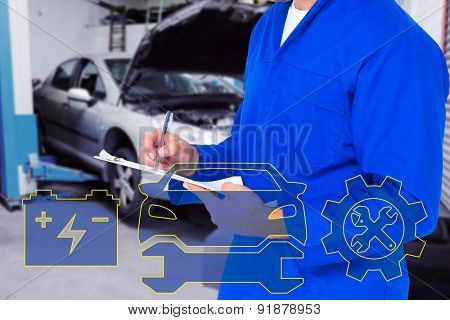 Midsection of mechanic writing on clipboard against workshop