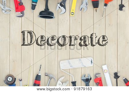 The word decorate against diy tools on wooden background