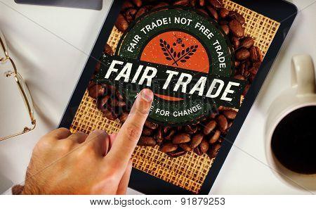 Man using tablet pc against fair trade
