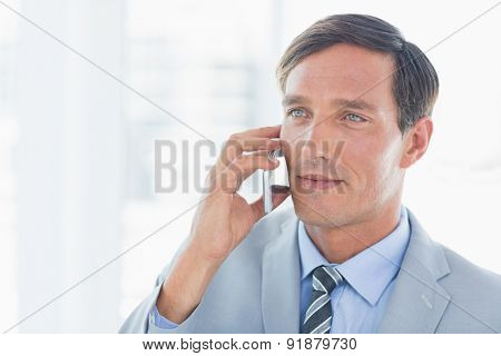 Business man having phone call in office