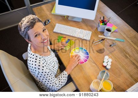 Casual businesswoman working with colour chart in the office