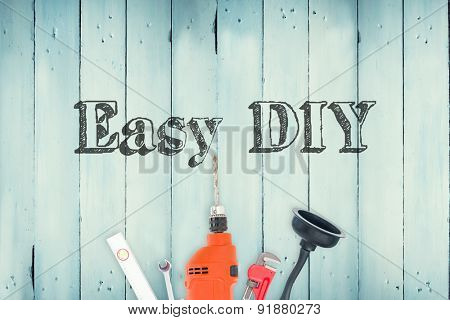 The word easy diy against diy tools on wooden background