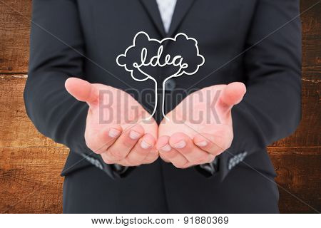 Businessman holding his hands out against overhead of wooden planks