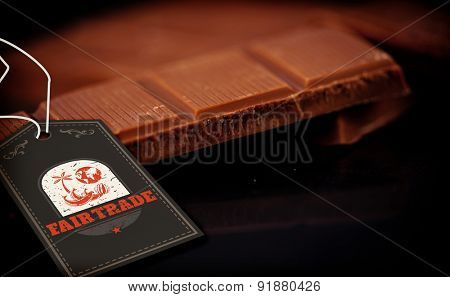 Fair Trade graphic against chocolate bar lying on chocolate