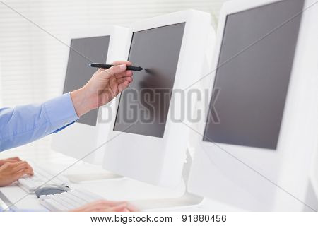 Business team working on computers in call center