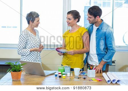 Casual business team having meeting in the office