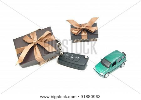 Two Brown Gift Boxes, Green Car And Keys