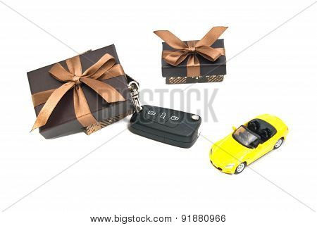 Two Brown Gift Boxes, Yellow Car And Keys