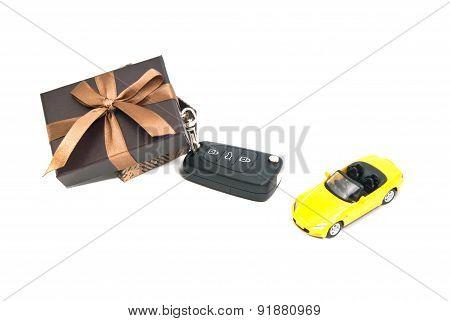 Gift Box, Yellow Car And Keys
