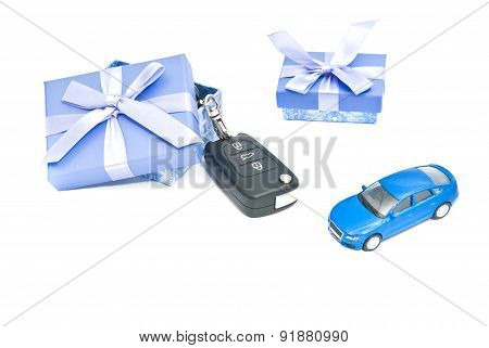 Two Gift Boxes, Blue Car And Keys