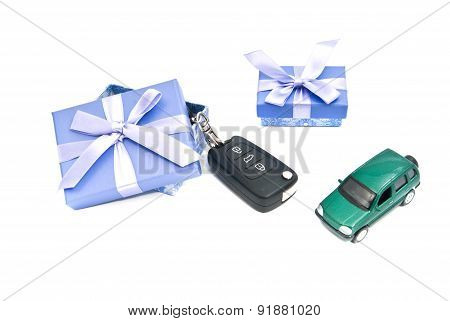 Two Gift Boxes, Green Car And Keys