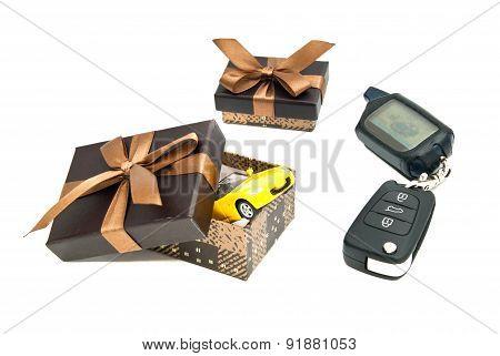 Car Keys, Yellow Car And Gift Boxes