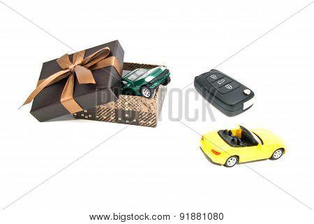 Green And Yellow Car, Keys And Brown Gift Box
