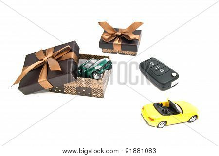 Green And Yellow Car, Keys And Brown Gift Boxes