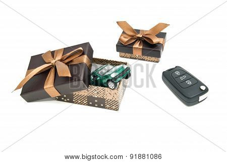 Green Car, Keys And Brown Gift Boxes