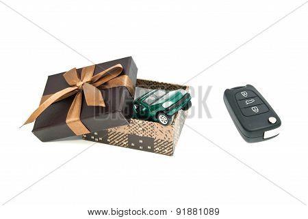 Green Car, Keys And Brown Gift Box