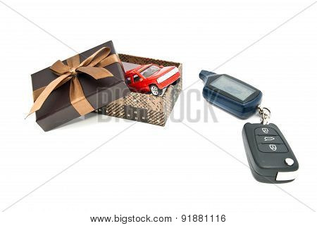 Red Car, Keys And Brown Gift Box On White
