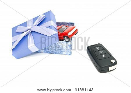 Red Car, Keys And Blue Gift Box