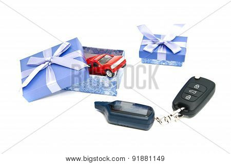 Red Car, Keys And Blue Gift Boxes