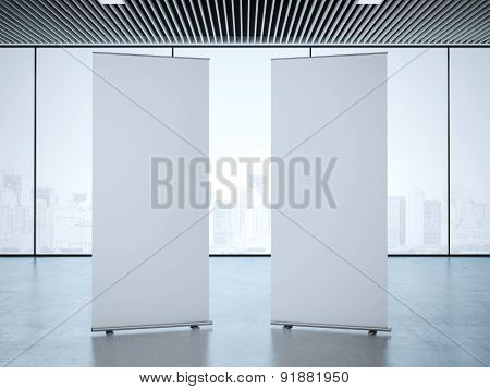 Two roll up banners at office. 3d rendering