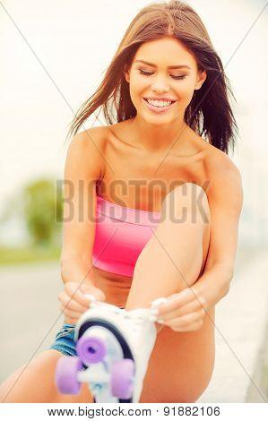 Tying Up Her Roller Skates.