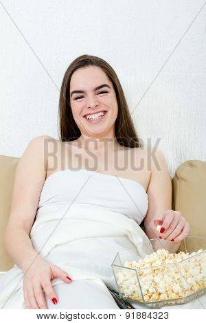 Girl Watching Movie Or Tv Laughing Having Fun Eating Popcorn