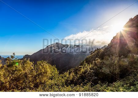 Green Mountains With Clouds And Sun