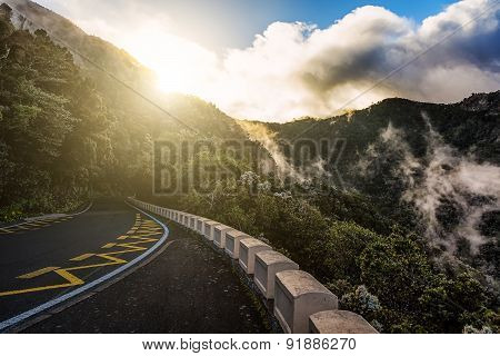 Road In Mountains At Evening Sunset