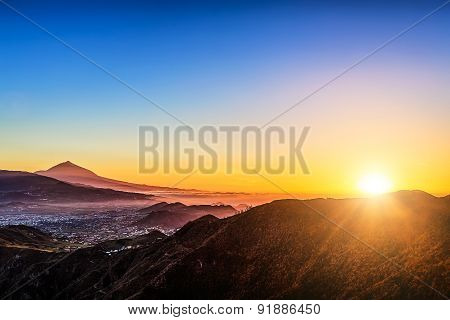 Sunlight Over Mountains And Teide Volcano
